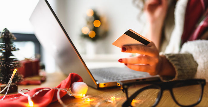 woman shopping on a laptop at christmas