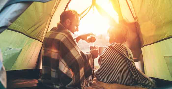 father and son camping in a tent