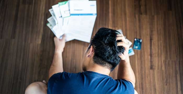 man confused over bills