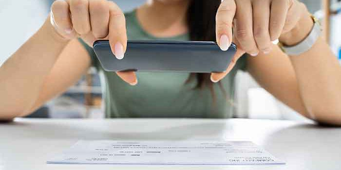 woman depositing a check using her phone